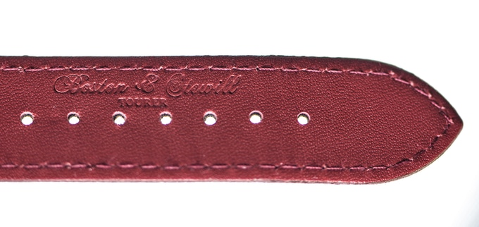 Embossed Boston & Stewill name on the red underside leather strap