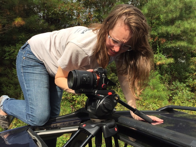 Co-director Gini Richards gathers Soul City b-roll from the sunroof of her car.
