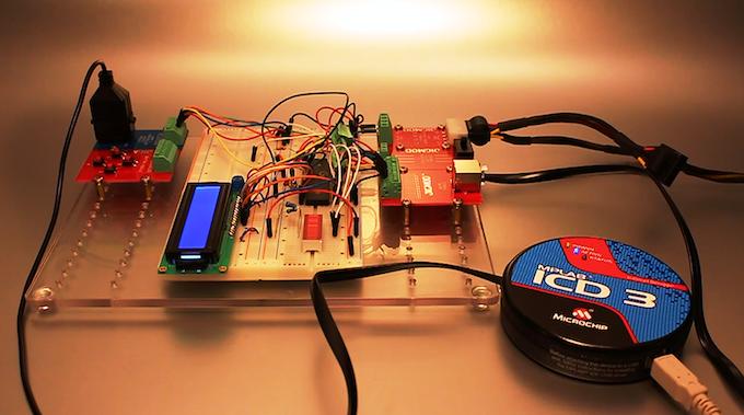 Raw Microcontroller Debugging using ATX PSU Plug JIGMOD, LCD Screen and Microchip ICD3 Programmer/Debugger connected through RJ12/14/45 JIGMOD, using JIGMOD XL Platform