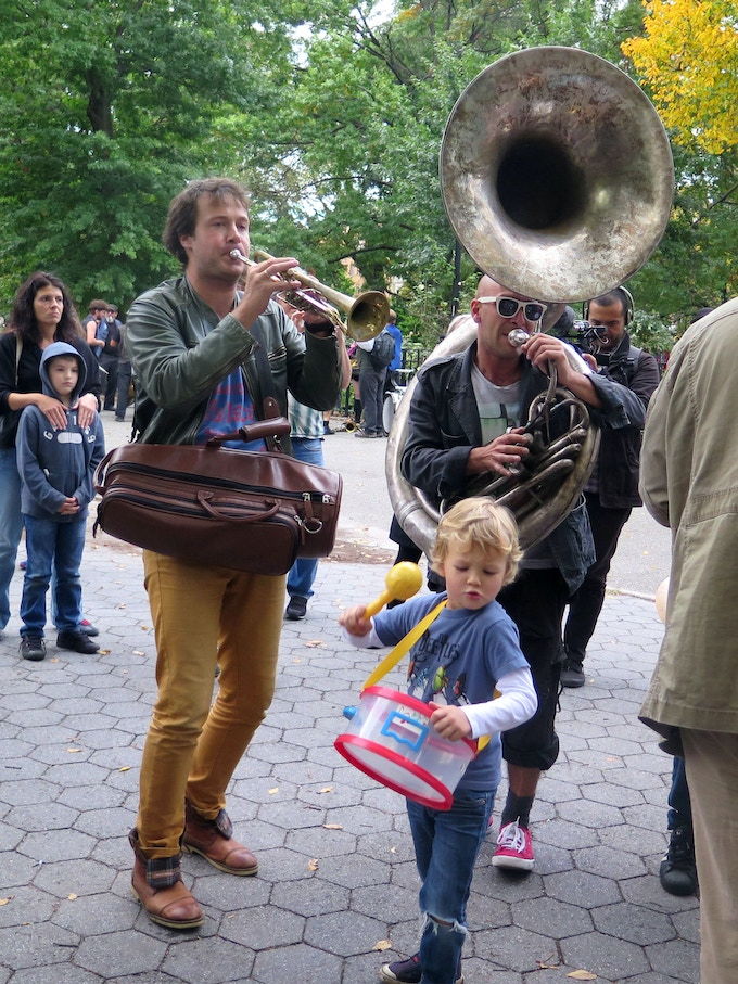 A local resident joins Moscow's PaKaVa It' in Tompkins Square Park, HONK NYC! 2014