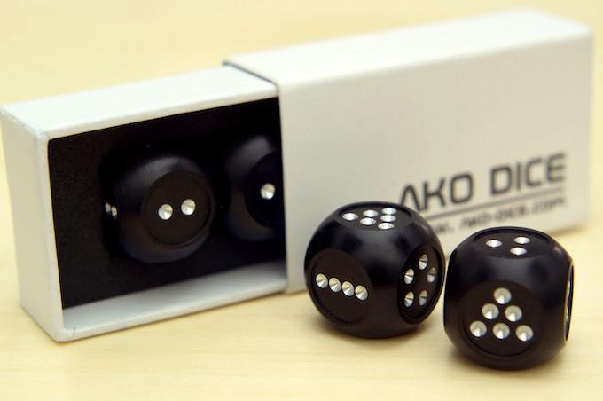 Each set of AKO Dice II come in white custom packaging.