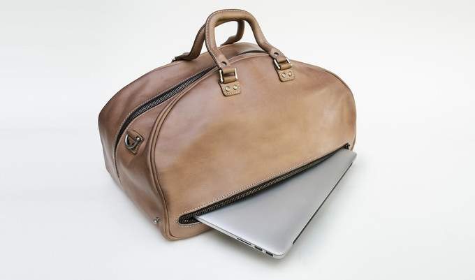 "The Classic Weekender easily accommodates computers up to 16.5"".  Picture here with a 15"" MacBook Pro."