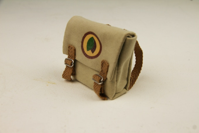 One-of-a-kind handmade cadet squirrel satchel, featured in the film. Tiny utility chic!