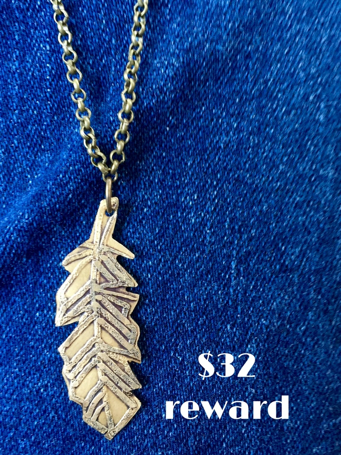 Hand-etched brass feather necklace designed by Waxwing shop owner Steph Davies, $32