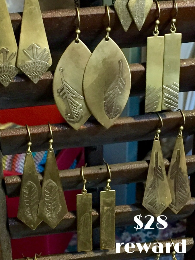 Hand-etched brass feather earrings created by Waxwing shop artist Steph Davies, $28 reward