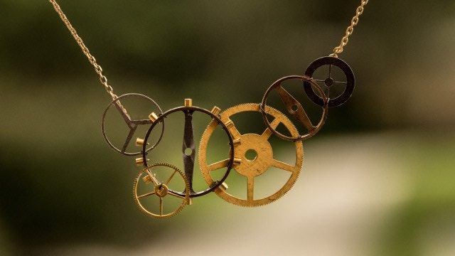 Carefully crafted from vintage pocket watch gears from the early 1900's, each necklace is unique.