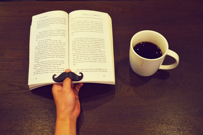 Nothing beats a coffee and a good book, especially when your book has a mustache!