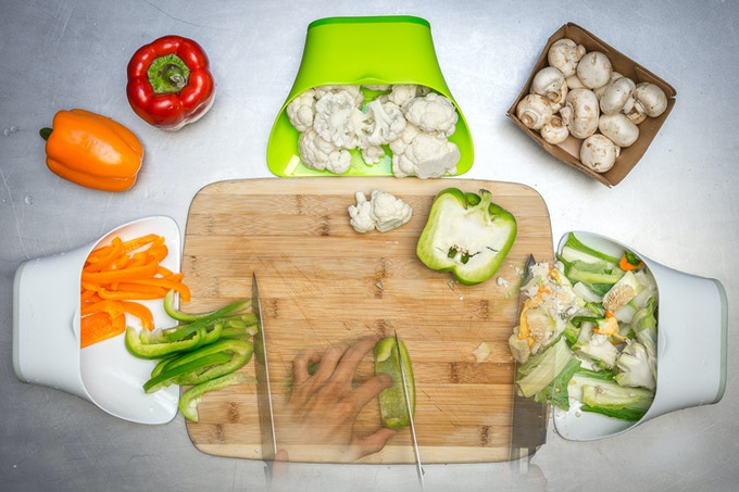 Expand your cutting board space by sweeping the ingredients into the ChopTainers while chopping.