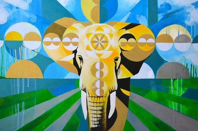 Yellow 'Elephant Power Mandala' on canvas, print, hoodie, or tee.