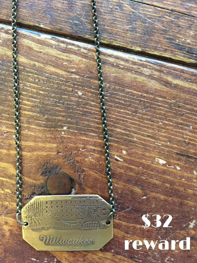 Hand-etched brass Milwaukee Skyline necklace created by Waxwing shop owner Steph Davies, $32 reward