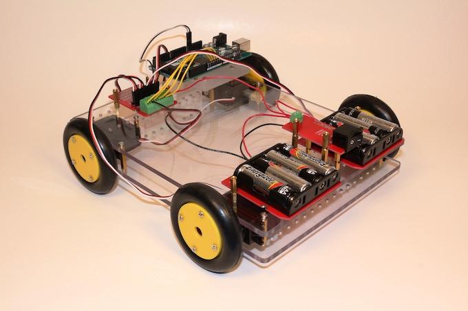 Robot Car built using an Arduino board, two JIGMOD XL Platforms, two 4AA Battery JIGMODs, and a Proto Board JIGMOD