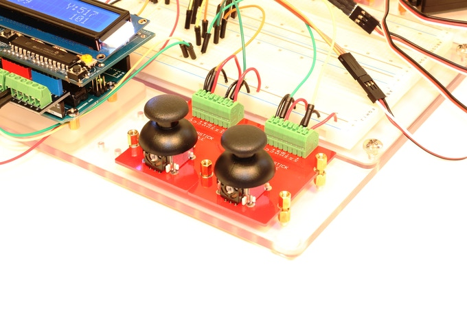 Two Thumbstick JIGMODs being used to test servos with an Arduino