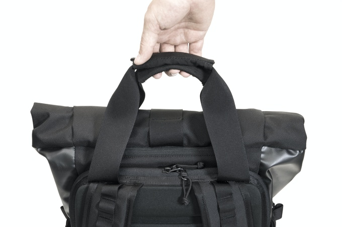 Magnetic tote handles make it easy to carry the bag when getting on and off of trains, buses, or planes.