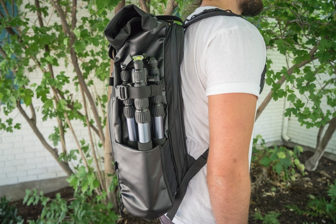 The side pocket unzips and expands to accommodate a travel size tripod or water bottle. When not in use, the pocket zips flat in adherence with the minimalist style.