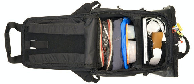 With the cube out, you can leave the bag's internal divider up so you have two separate compartments for more organized packing...