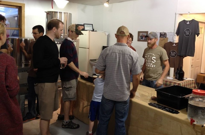 Matt & Carol serving beer in our current brewery space