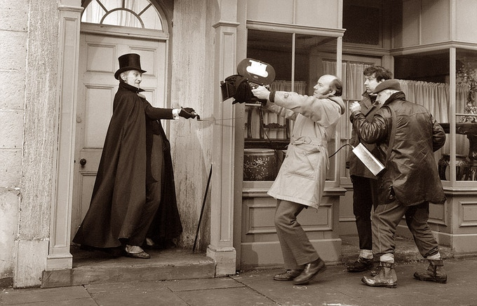 Cameraman Neil Binney films Peter Cushing as he wields his gruesome sickle in the doorway of Dr. Heidecke's surgery, during the film's opening scene. Frankenstein Must Be Destroyed, 1969.