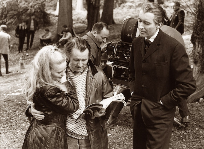 Director, Freddie Francis goes over a scene with Veronica Carlson and Christopher Lee, on location in Black Park. Dracula Has Risen From the Grave, 1968.