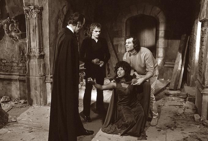 Christopher Lee, Christopher Neame, Marsha Hunt and director Alan Gibson filming on the St. Bartolph's Church set. Dracula A.D. 1972