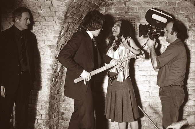 Michael Coles (as Insp. Murray) and William Franklyn (as Torrence), filming the destruction of Jane (Valerie Van Ost), on the set of Satanic Rites of Dracula, 1974.