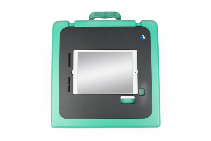 The bottom features oversized pressure sensitive adhesive grips as well as mounting options for screws, posts or straps.