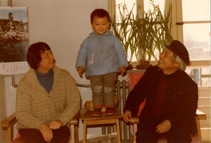 Ann with her husband and son in China