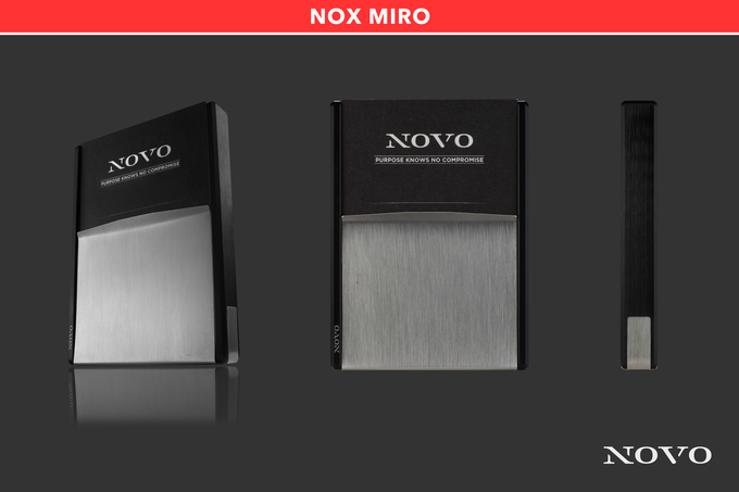 The Nox Miro metal wallet juxtaposes the black aluminum core with a brushed stainless steel vise for an appealing contrast of light and dark.