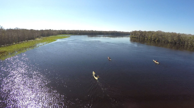 "The Expedition team is captured paddling along the Suwannee River, one of the ""forgotten coasts"" the captured along the team's journey. Photo by Carlton Ward Jr."