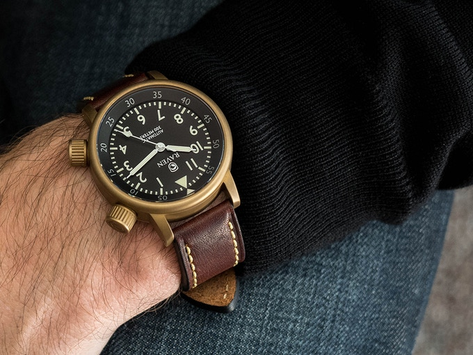 Raven Defender, brass on brown leather