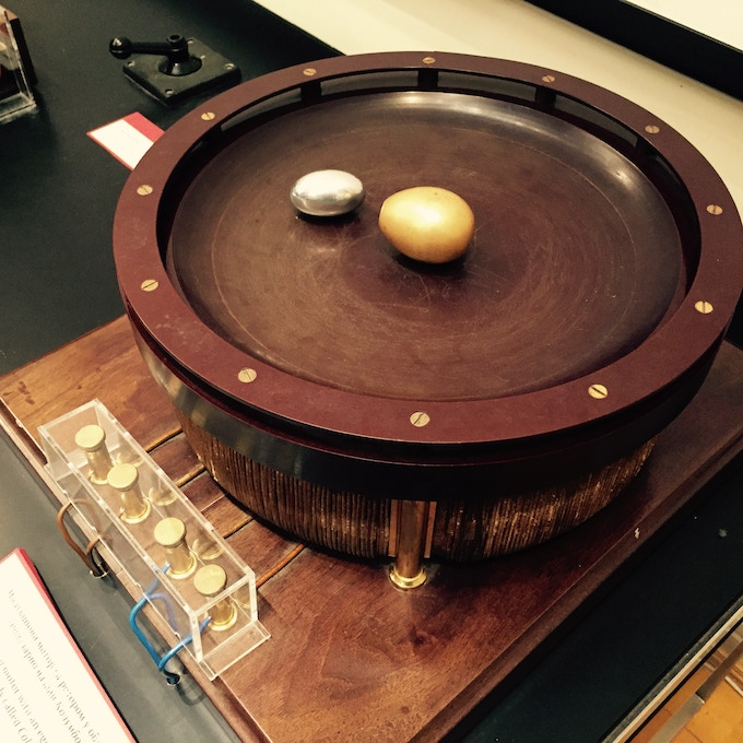 Replica of Tesla's Egg of Columbus demonstration apparatus employing a rotating magnetic field on top of which sits their copper egg and our aluminum PhiTOP.
