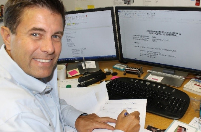 Fred Hafer, Jr. signing the NERF™ License Agreement