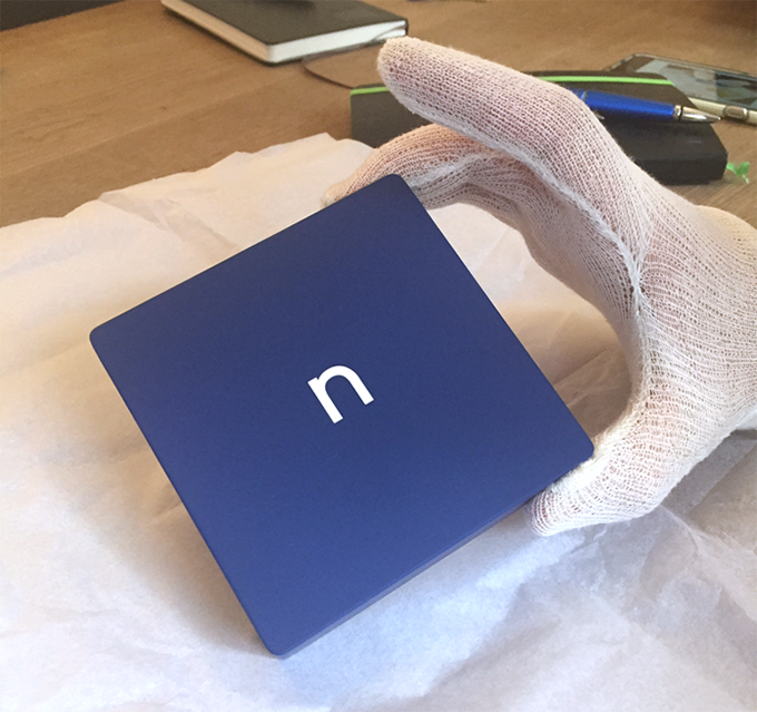 Our first prototype! 3D printed and hand polished before a coat of rich, dark blue paint and a small white n are applied. Gloves: non-negotiable.