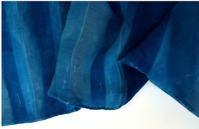Sun dyed silk with pattern created through pleating.