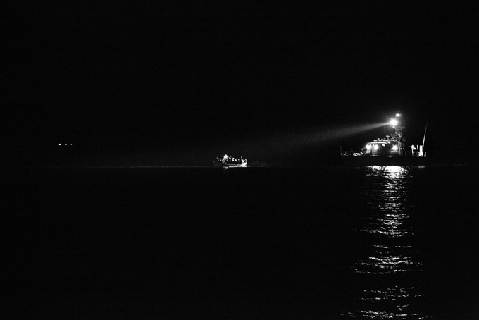 Italian Coast Guard intercepts a boat full of African migrants near Lampedusa Island, Italy.