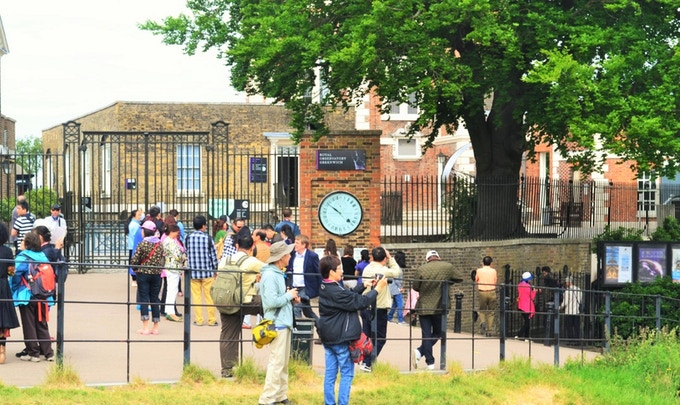 The Shepherd Gate Clock mounted on the wall of the Royal Greenwich Observatory today