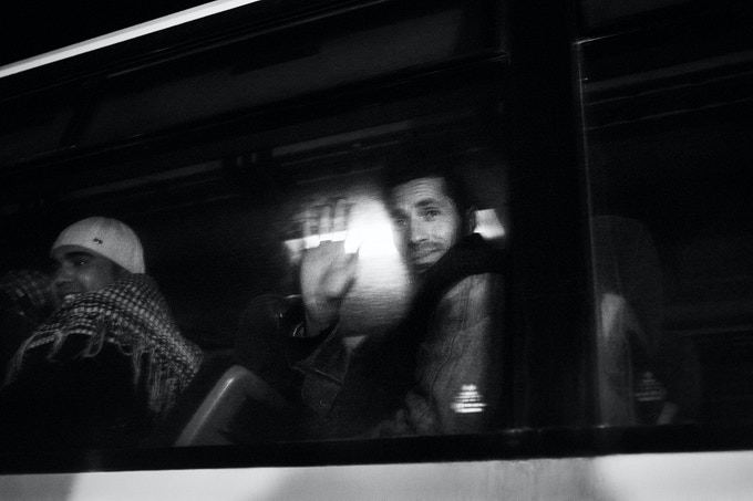 Tunisian refugees on the bus that bring them to the first reception centre after their arrival at the italian island of Lampedusa.