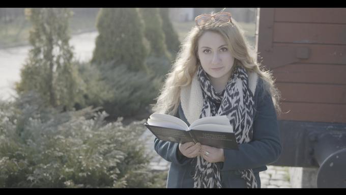 Serena reading Maryla's memoir in the Bedzin Ghetto Memorial