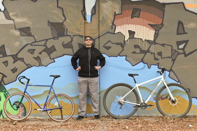 "Drew is 6'8"". On the left a regular 700c bicycle (66cm frame) and on the right a production DirtySixer size S."