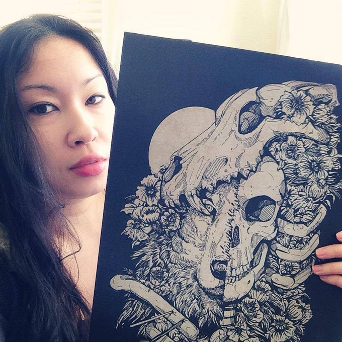 Me holding an A3 print of Wolfchild