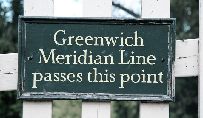 A sign indicating the passage of the Greenwich Meridian Line