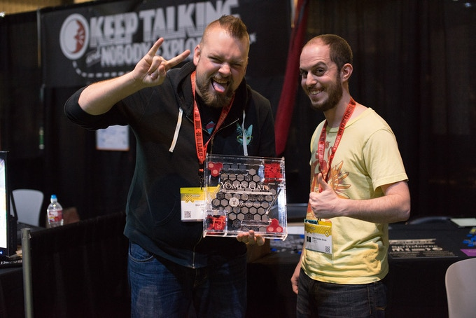 Don Thacker and I at SXSW showing off the first copy of Yomi's Gate ever sold. Photo credit goes to Kazuo Mayeda.