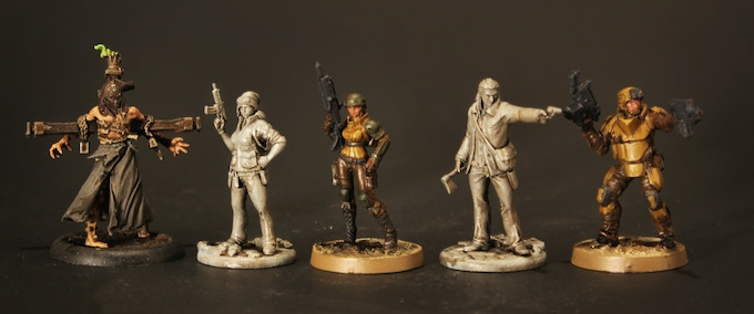 Blackout miniatures shown alongside Malifaux and Infinity miniatures for comparison.