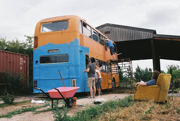 Painting the bus with wet towels (CEO in the chair)