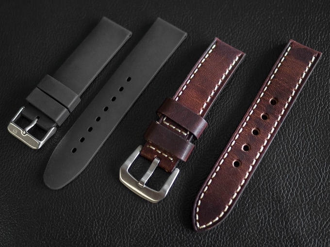 Raven Defender, black rubber and brown leather straps.