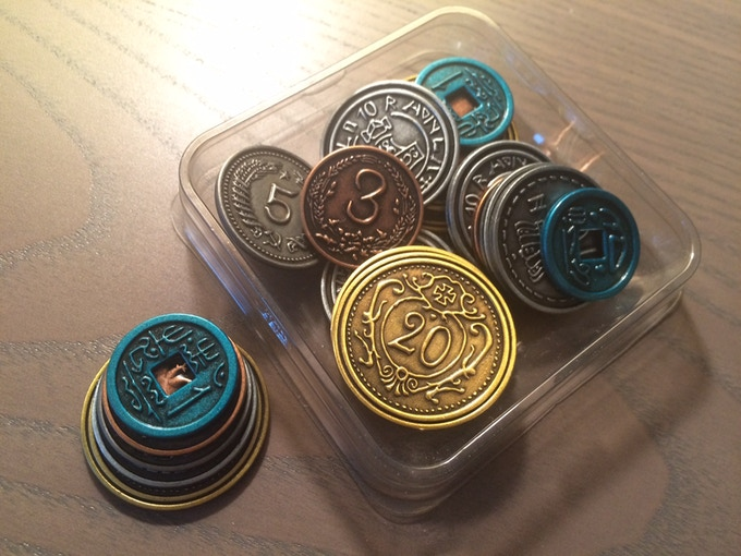 Plastic container with coin prototypes.