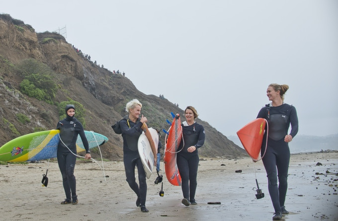 Andrea Moller, Keala Kennelly, Bianca Valenti, and Paige Alms about to surf Maverick's.