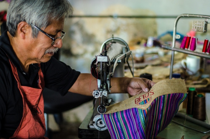 DON BETO HANDMAKING A BURLAP BAG ON HIS FOOT-PEDALED SINGER