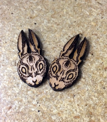 Cottontail lapel pin in alder wood