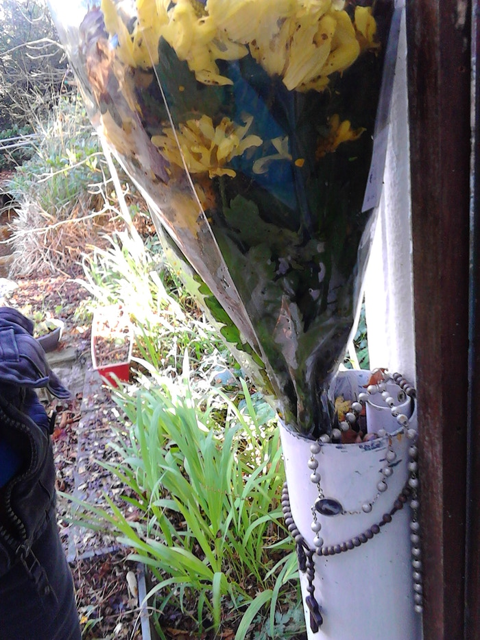 People leave things beside Bridget or for her flowers were here today as well as rosary beads