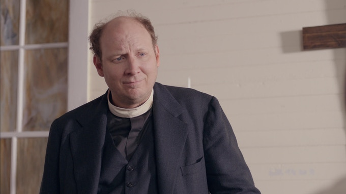 """DAN BAKKEDAHL as """"Reverend Ray"""""""